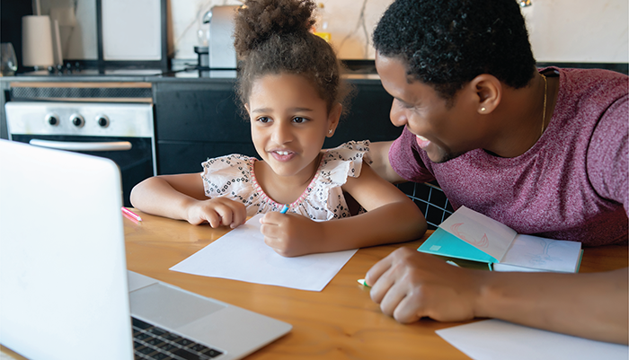 Cropped image of Home Access Playbook cover shows image of young child and adult learning together in kitchen with laptop computer.