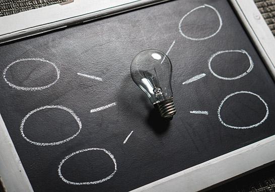 Lightbulb on mind map on a chalkboard